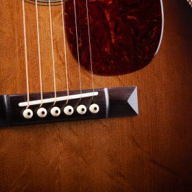 Dark Brown Tailpiece on Ombre Guitar